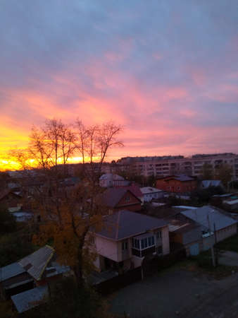 beautiful sunset in the city with heavy orange clouds. High quality photo Standard-Bild