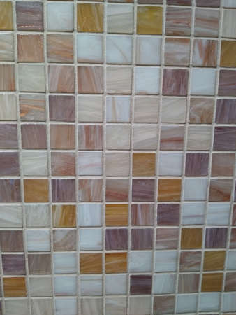 background of white and beige tiles in a small square randomly. High quality photo Standard-Bild