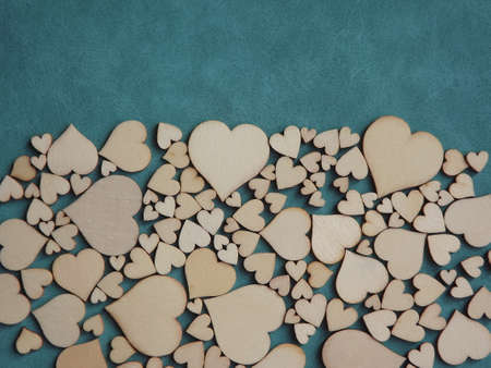 valentines day greeting card-wooden hearts on a gray suede background. High quality photo Standard-Bild
