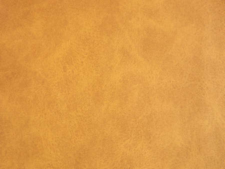 Suede surface in beige and mustard color as a background. High quality photo