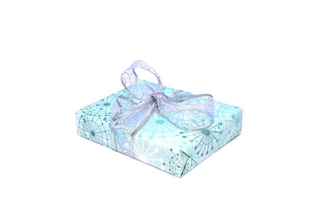 wrapped holiday gift box silver ribbon isolated on white Imagens