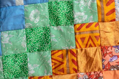 Orange patchwork quilt fragment, Colorful handmade ethnic blanket.