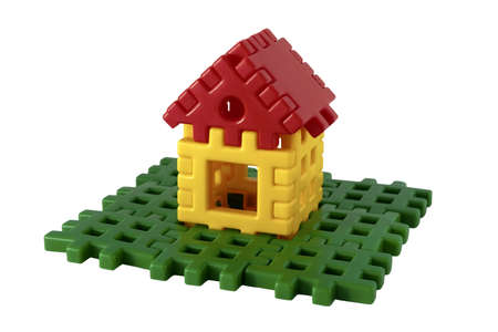 Isolated Small house and lawn from the children's constructor Stock Photo - 9420385