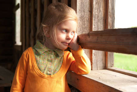 wistful: Pretty wistful girl near the window Stock Photo