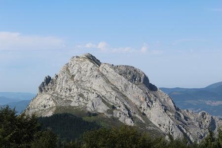 escalation: Mountain   a rock on green valley