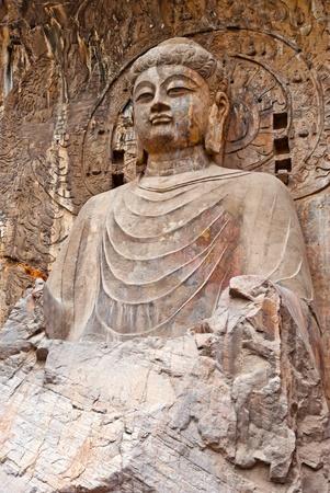 仏龍門石窟の大きな大日如来。洛陽、中国 写真素材
