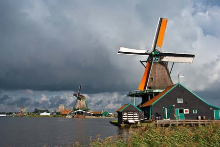 Windmills in Zaanse Schans, Netherlands photo