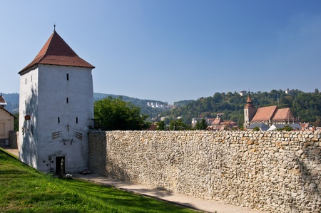 brasov:   Old city wall and the Black Church at background. Brasov, Romania Stock Photo