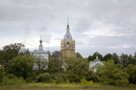 ?hurch of a Sign (Znamenskaya) and Church of the Deposition of the Robe (Rizopolozhenskaya) on a Mzhara. Suzdal, Golden Ring of Russia. photo