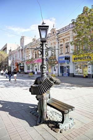 passerby: Monument to the Saratov accordion. Saratov, Russia Editorial