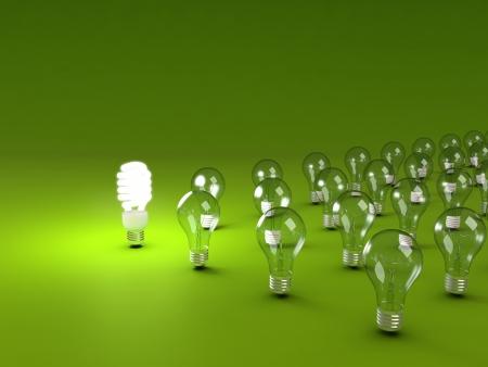 eficiencia energetica: El ahorro de energía y simples bombillas aisladas sobre fondo verde. Foto de archivo