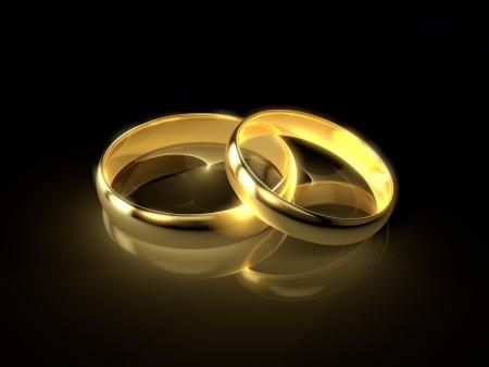 anillo de boda: Dos anillos de bodas de oro aisladas sobre fondo negro Foto de archivo