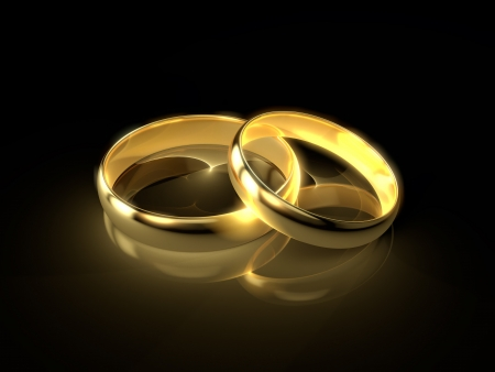marriage invitation: Two golden wedding rings isolated on black background  Stock Photo