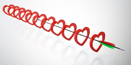 enamoured: Bow arrow flying through the heart rings Stock Photo