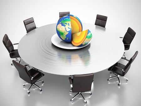 Cut Earth on the plate at round table Stock Photo - 13515813
