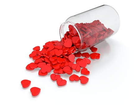 Heart pills spilled from prescription bottle on white background Stock Photo - 13515275