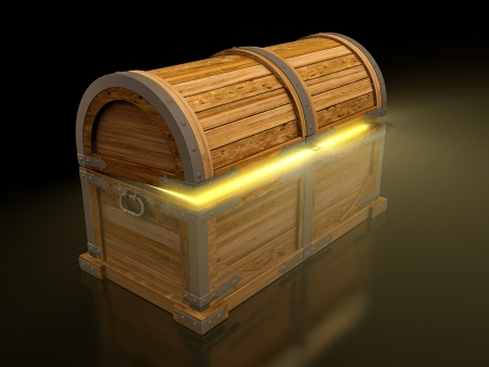 Old treasure chest isolated on black background photo