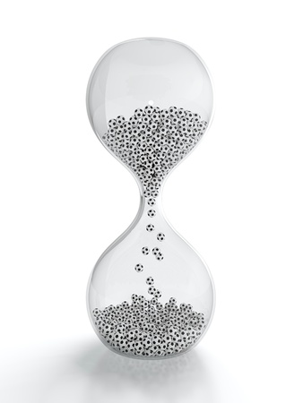 3D render of hourglass with soccer balls inside it photo