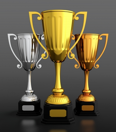 3D render of gold silver and bronze trophy cups on black background photo