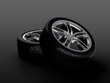 3D render of two car wheels on black background Stock Photo - 14095410