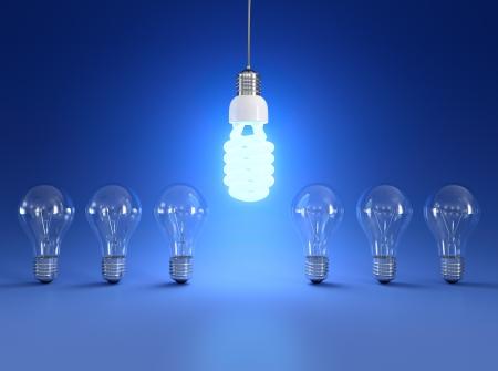 ahorro energia: Ahorro de energía y simples bombillas aisladas sobre fondo azul.