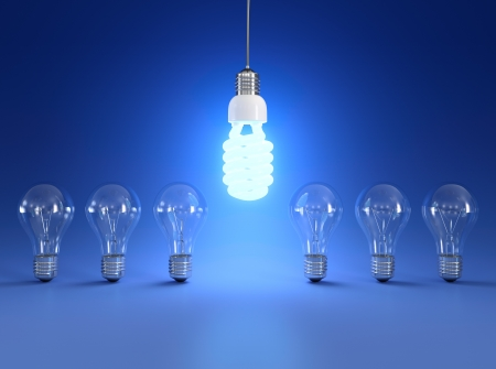 energy saving: Energy saving and simple light bulbs isolated on blue background.