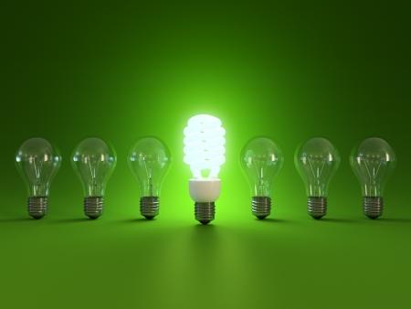 ahorro energia: Ahorro de energ�a y simples bombillas aisladas sobre fondo verde. Foto de archivo