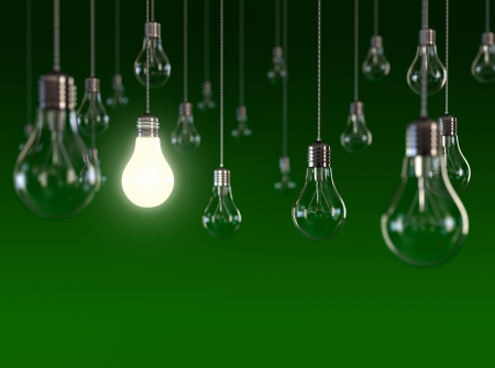 bulb idea: Hanging light bulbs with glowing one isolated on dark green background