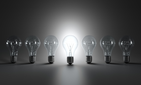 innovation concept: Grayscale image of light bulbs in a row