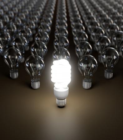eficiencia energética: Ahorro de energía y simples bombillas aisladas sobre fondo marrón.