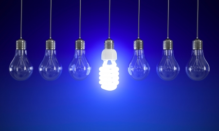 fluorescent: Energy saving and simple light bulbs isolated on blue background.