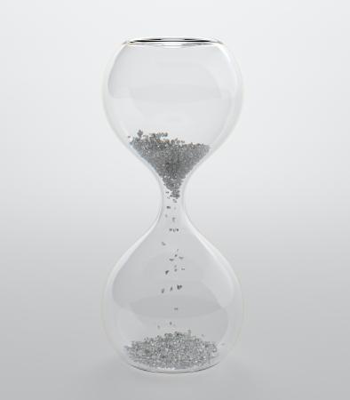 half full: 3D render of hourglass with diamond grain