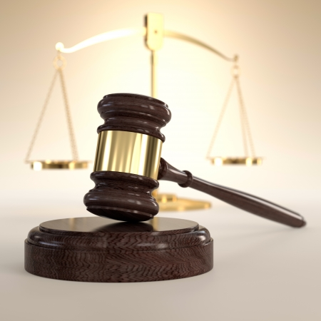 criminal law: 3D illustration of scales of justice and gavel on orange background