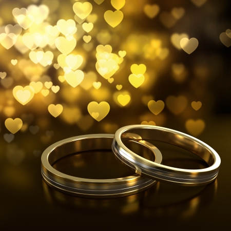 golden ring: Two golden wedding rings with heart bokeh on background