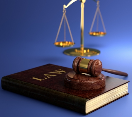3D illustration of scales of justice, gavel and book on blue background. Law concept illustration