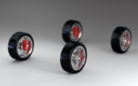 3D render of four car wheels on gray background Stock Photo - 17439055