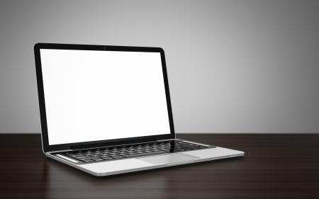 laptop: 3D image of modern laptop with blank screen on wooden table next to gray wall Stock Photo