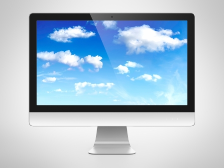Computer monitor with cloudy sky image on screen. Cloud computing concept. photo
