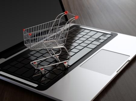 Imagen generada por ordenador de la cesta de la compra en la computadora portátil. E-commerce concepto.