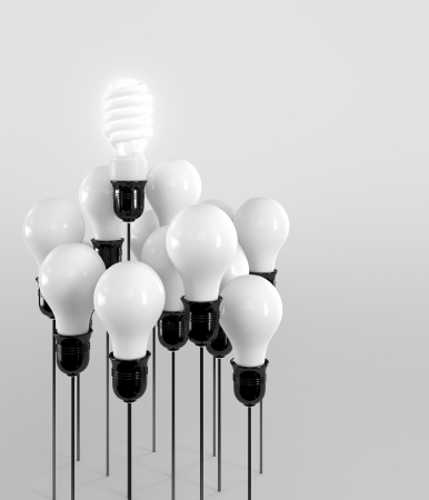 Energy saving and simple light bulbs isolated on brown background  photo