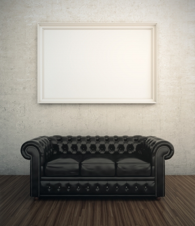 couch: Black leather sofa next to white wall with blank frame Stock Photo