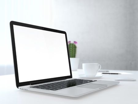 Place of work with electronic devices on desk next to the wall and window Stock Photo