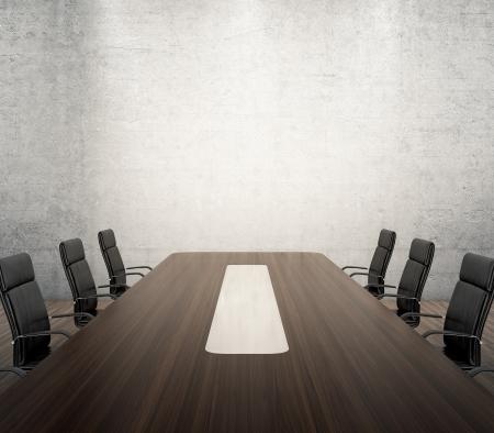 sala de reuniones: Render 3D de sala de reuniones con mesa de madera y sillones negros junto a la pared con focos