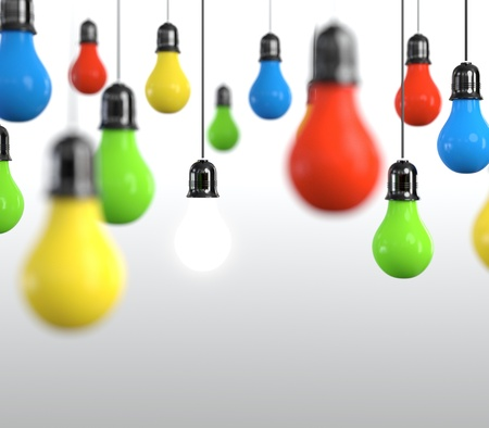 Hanging multicolored light bulb on bright background. photo