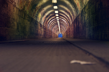urban tunnel with graffiti and light photo