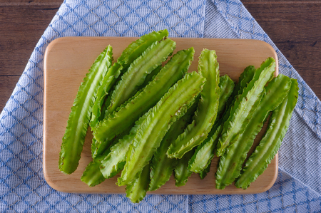 green bean: Winged beans on cutboard wooden background, Princess bean, Goa bean