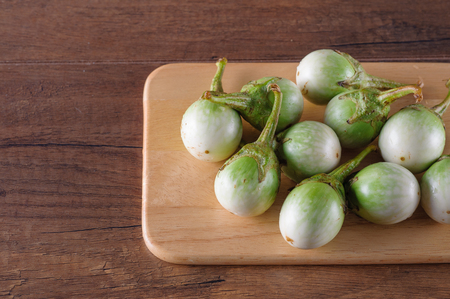thai eggplant vegetable on cut board wooden background