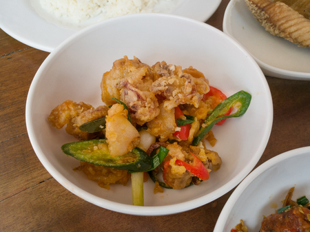 Stir Fried Squid with Salted Egg Yolk thai food selective focus Stock Photo