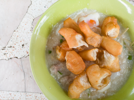 Rice porridge rice gruel congee rice soup with egg and pork