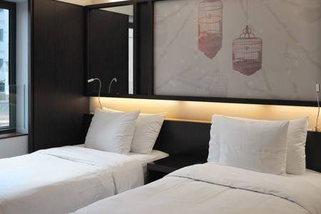 Luxury room with two beds in a modern hotel. 免版税图像